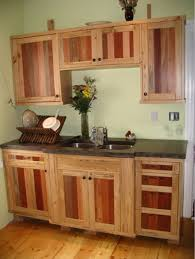 kitchen cabinets made from reclaimed ash and tropical hardwood pallets for the panels no stain