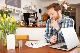 male customer filling in form in cafe