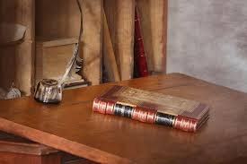 red book photograph old fashioned desk with antique book and quill photograph by colleen cornelius