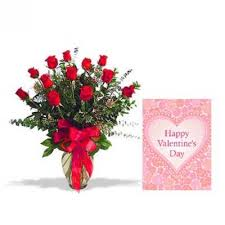 roses vase with valentine greeting card