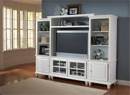 furniture white wooden wall shelving unit with racks and doors also tv space on the