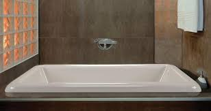 drop in rectangle bath installed in an alcove