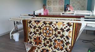 Sparrow Studioz - APQS Canada's Studio Blog & Our St Albert Studio has been busy today. Carol & Co were teamed up  finishing this sweet memory quilt. Betty Jean drove into town to finish her