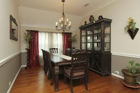 Dining room - contrasting wall colors with white chairrail.