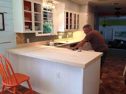 We had laminate countertops and found butcher block type boards at Lowes.  We nails the boards right on top of laminate. We also used heavy duty wood  glue.