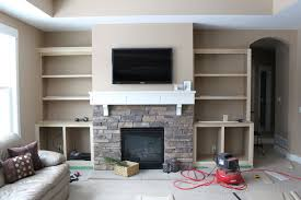 casual interior decoration with shelving around fireplace gorgeous image of living room decoration using cream