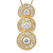 bezel set three stone diamond pendant w small diamonds surrounding