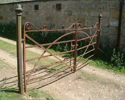 wrought iron gate at steading by old kirkyard crathie