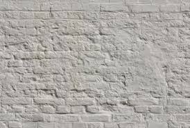 Removing layers of paint from brick is a time-consuming process.