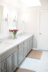 white along with the shiplap and a light greige color called behr mineral on the walls we added marble hexagon floor tiles with white grout and marble