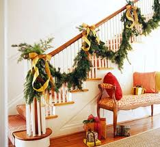 Give the traditional staircase evergreen swag a burst of fresh color with  gorgeous yellow ribbons.