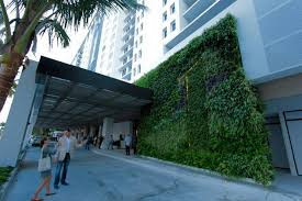 the environmentally focused 1 hotel south beach features a green wall at its main entrance