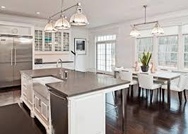 white kitchen dark wood floor. Modern Concept Dark Wood Floor Kitchen The White With Gray Counters And Stainless Appliances Leans