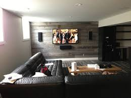 home theater wall speakers. beautiful in-wall speaker system installed on a wall covered with barnboard. what an innovative treatment! great for sound, too! home theater speakers