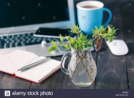 top office table cup. Top View Office Desk Mockup: Laptop, Flower, And Cup Of Tea On Rustic Wooden Background Table