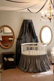 elegant baby furniture. Modern Round Baby Crib With Gray Skirt Idea Also Elegant Nursery Room Design Chandelier And Oval Wall Mirrors Furniture