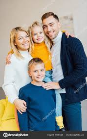 happy family cal clothes hugging looking camera stock photo