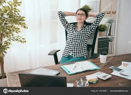 business woman manager lying down on office chair stock photo