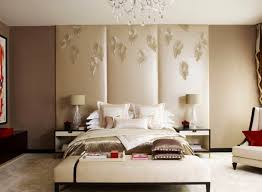 a quick and effective way to fill the empty wall space behind your bed involves hanging a room divider this three panel version in silk is especially
