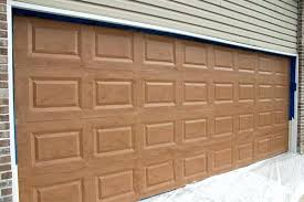 garage door paint to plete your wood look use the magnetic carriage style garage door accents this will give your garage that sleek expensive look that