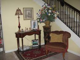 antique entryway furniture. Grandiose Brown Fabric Accent Chair Feat Antique Foyer Table On Red Rugs As Well Stairs Case In Loft Ideas Entryway Furniture N