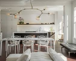 midcentury lighting. inspiration for a contemporary dark wood floor great room remodel in san francisco with white walls midcentury lighting
