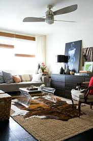 layered cowhide rug layered cowhide rug fresh tips to help you master layering rugs layered cowhide