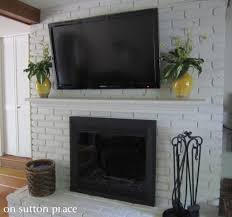 mounting tv on brick fireplace living