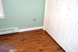 look how well she got the flooring placed under the rediator trim and doorway