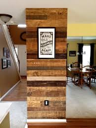 pallet wood accent wall bathroom. accent wall faced with old pallet wood. each board individually finished various stains and wood bathroom w