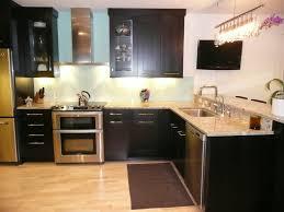 kitchen tile flooring dark cabinets. Kitchen. Black Wooden Kitchen Cabinet With Storage And Cream Counter Top Plus Sink Placed On Tile Flooring Dark Cabinets A