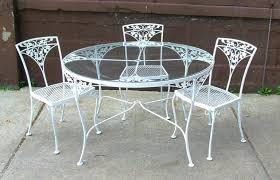 round glass patio table