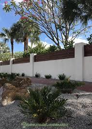stucco wall with hardwood top house