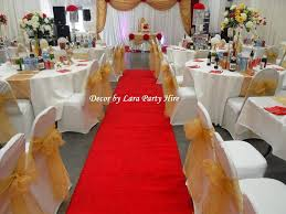 white chair covers gold organza sashes
