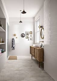 wood vanity in the bathroom hex floor tile