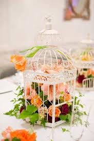 amaryllis wedding birdcage centerpiece bridal shower bright orange  ranunculus carnation tulip parrot smilax garland geranium