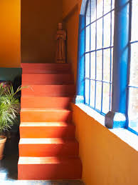 Orange Wall Paint Living Room Orange Wall Paint With Pictures Plus Brown Sofa On The F Wooden