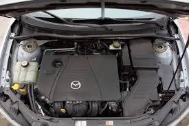 image from identifying the parts under the hood on a mazda l