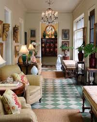 The entire sunroom was painted the same neutral color to effectively make  the traditional art collection