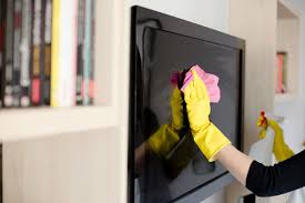 how to clean your lcd or plasma tv version 1390384840 58617618 woman in  yellow rubber gloves