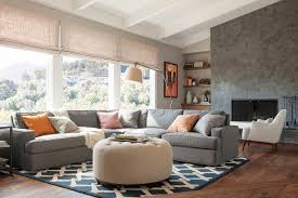 round sectional sofa with modern coffee table ottomans living room contemporary and blue patterned rug