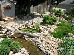 Rocks Landscaping Ideas With Wooden Trunk