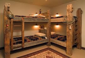Traditional style bunk beds featuring timbers and Western accents ...