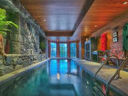 residential indoor lap pool. Meticulously Designed Indoor Pool With Rock Wall, Plants, Wood Ceiling And Paneling Along Residential Lap I