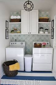 DIY laundry room update with stenciled walls and DIY painted vinyl floors  via View Along the