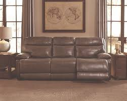 bachelor pad furniture. grey leather reclining sofa in a dim light empty room with two windows and wall art bachelor pad furniture e