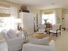 coastal furniture ideas for living room in white theme with white slipcovered sofa and rounded table also rectangular jute rug