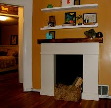 interior white fireplace mantel with brown wooden shelf and doouble wall shelves on cream wall