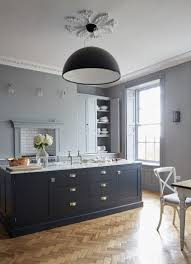get the look for similar cabinetry try british standard by plain english the handles are from rowen wren this is the skygarden pendant by marcel