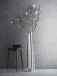 mirror floor vase with fresh blooms